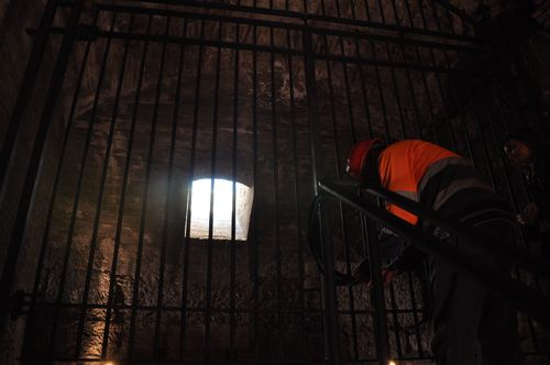 Worker unlocking the door for the third level of the Colosseum