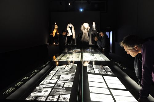 Costumes from Fellini films in the background, with pictures of previous movies in foreground, Cinecitta, Rome