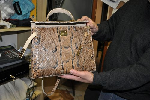 Snakeskin purse at leather workshop, Rome