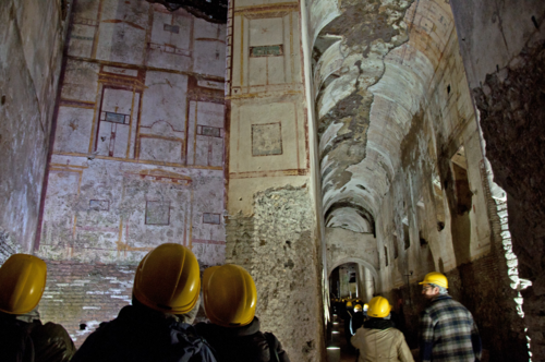 Visitors touring the Domus Aurea of Rome